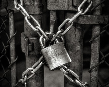 Chains and padlock holding a gate shut